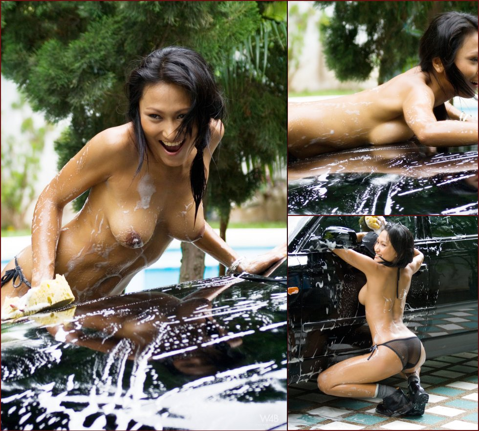 Tanned Asian is washing a car - 16