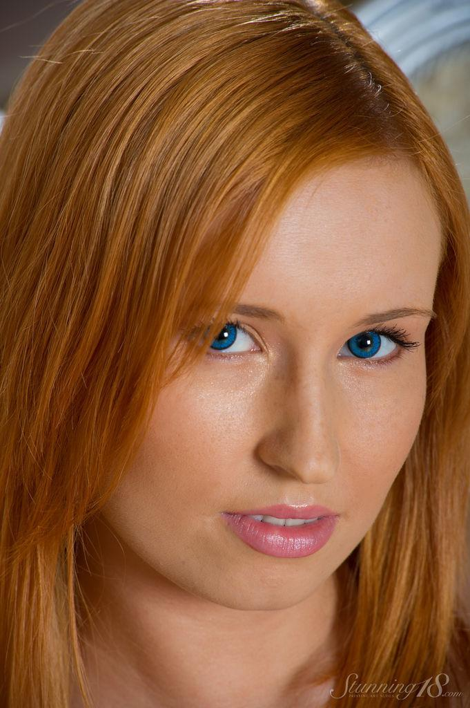 Blue-eyed redhead shows young body - Nikky - 1