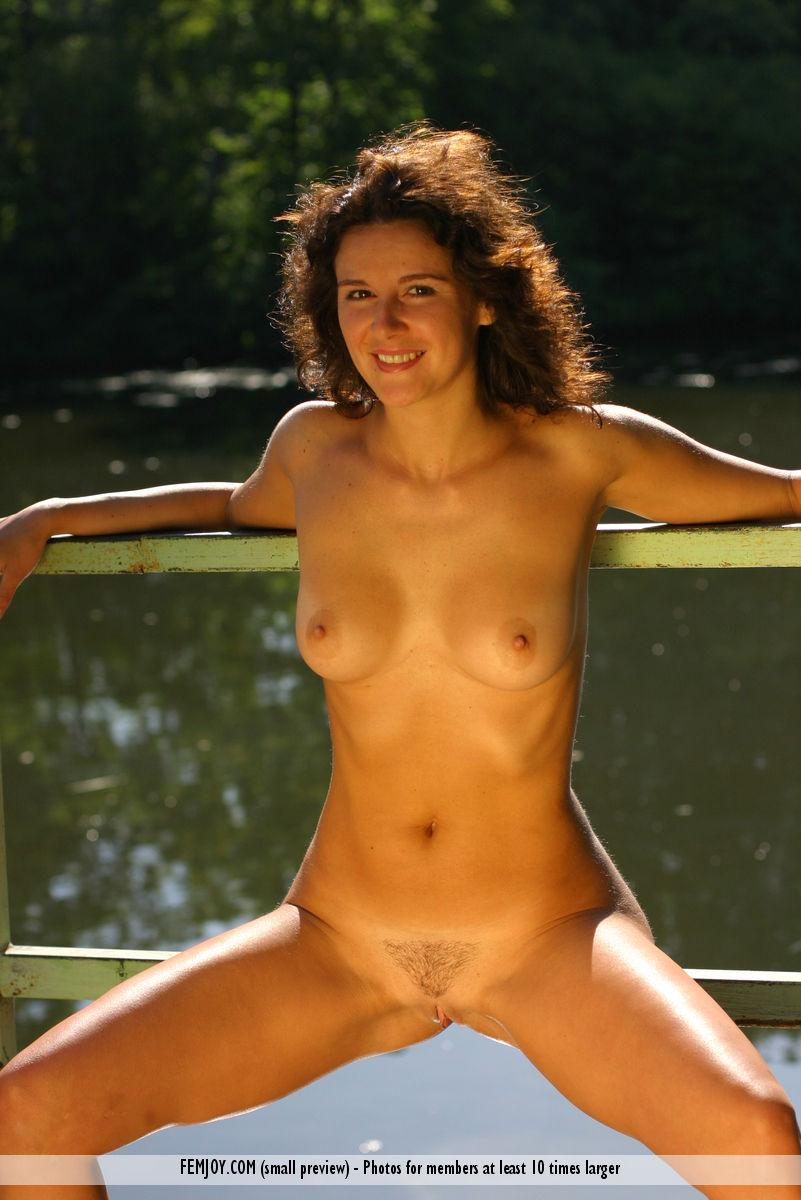 Karina is posing naked in water - 1