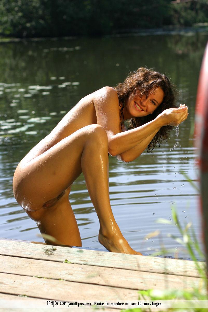 Karina is posing naked in water - 10