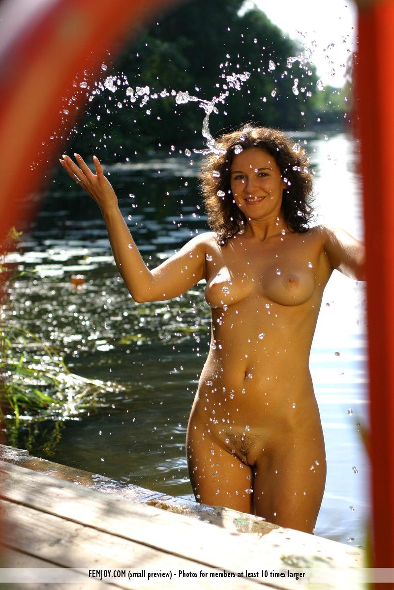 Karina is posing naked in water - 12