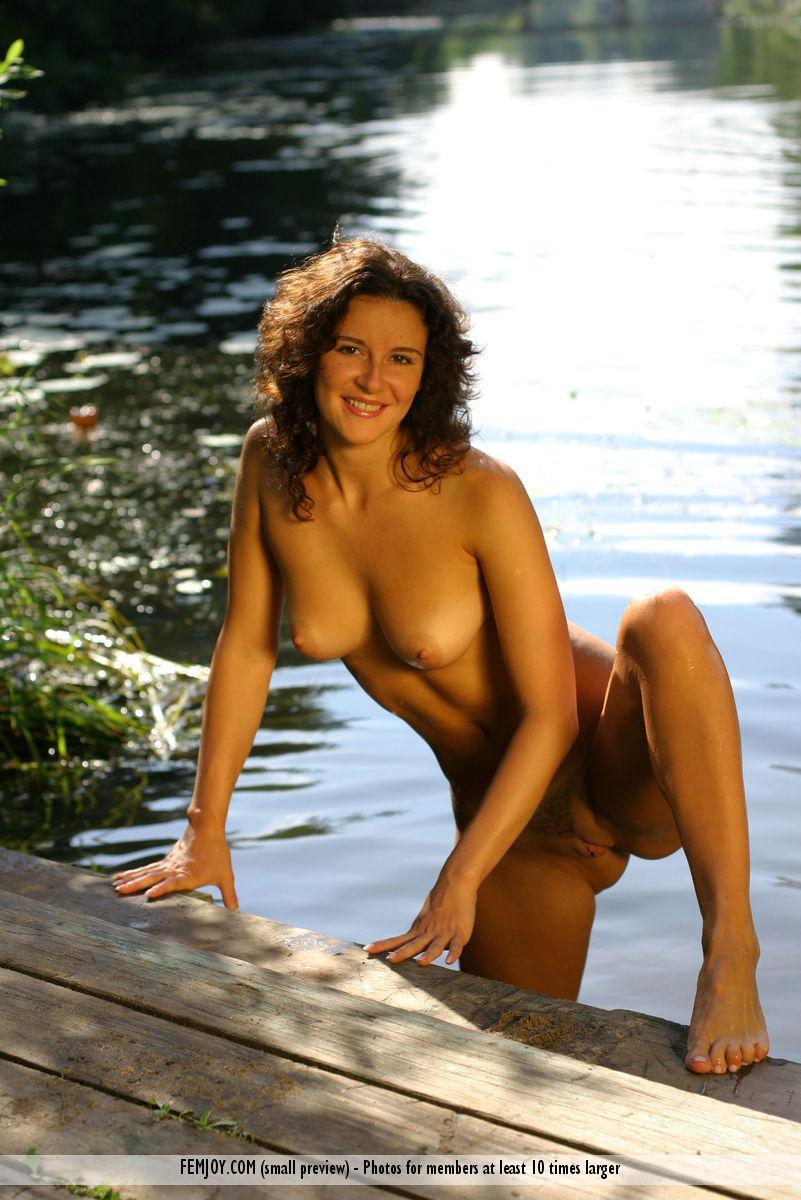 Karina is posing naked in water - 6