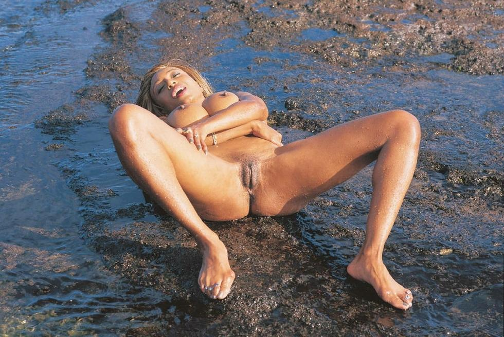 Busty ebony is posing on the beach - Anna More - 7