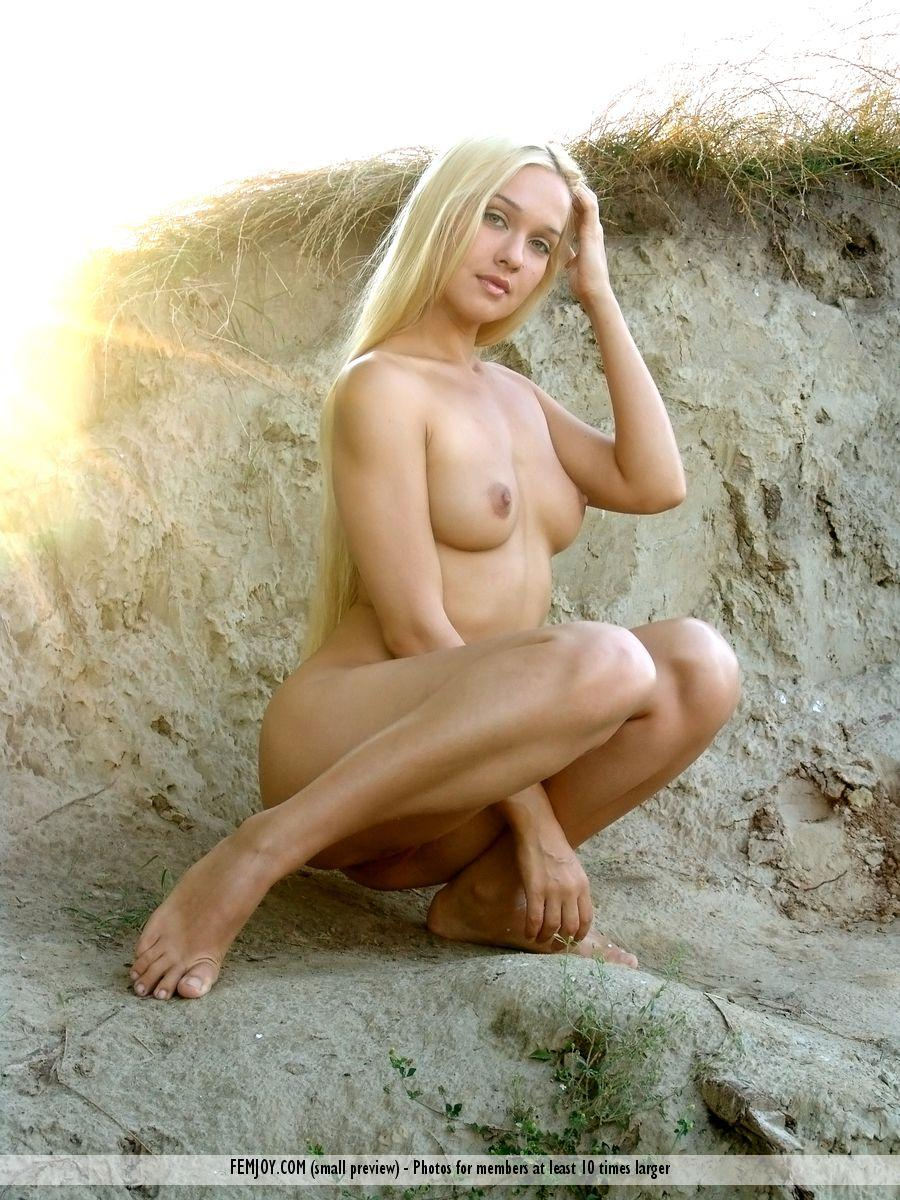 Long-haired Desiree is posing naked on the beach - 1