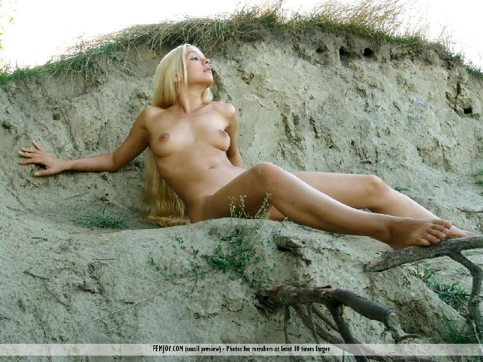 Long-haired Desiree is posing naked on the beach - 10
