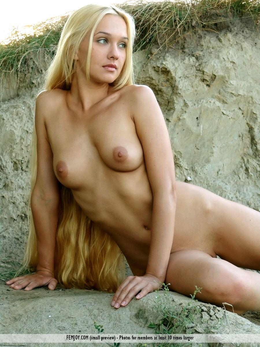 Long-haired Desiree is posing naked on the beach - 11