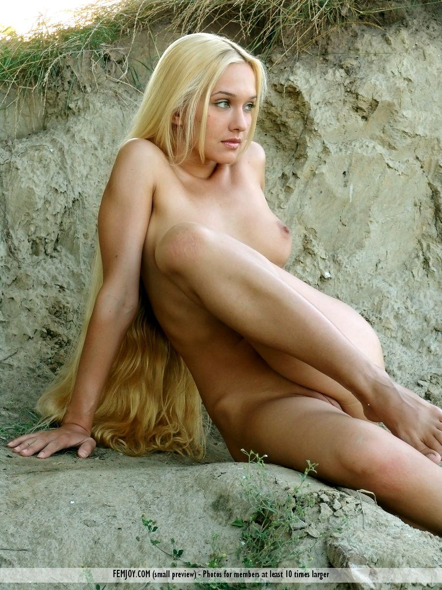 Long-haired Desiree is posing naked on the beach - 12