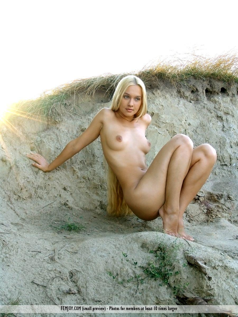 Long-haired Desiree is posing naked on the beach - 2