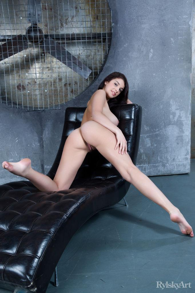 Amazing Evita Lima is posing on black sofa - 4