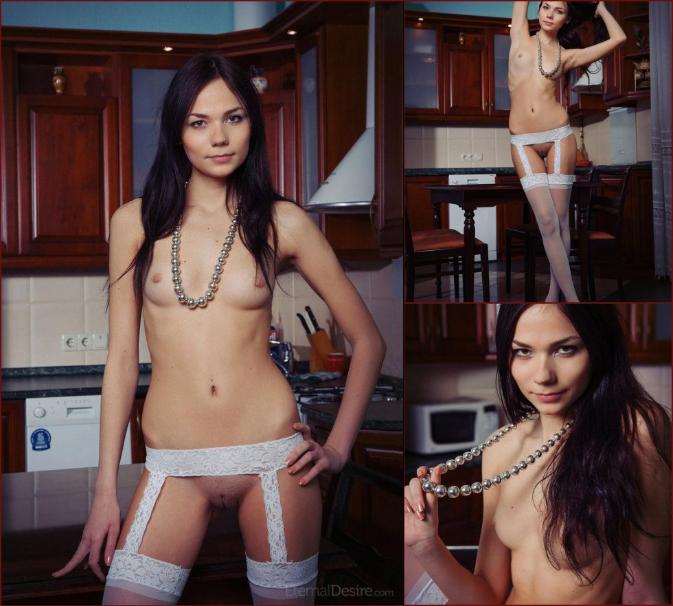 Young and naked Julia in the kitchen - 14