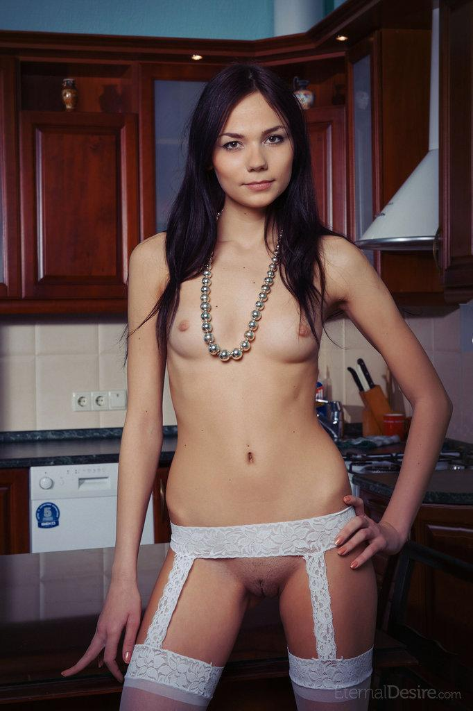 Young and naked Julia in the kitchen - 1
