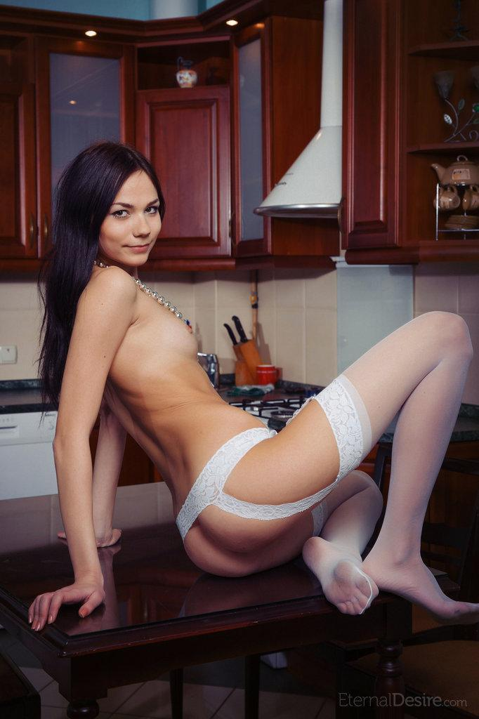 Young and naked Julia in the kitchen - 11