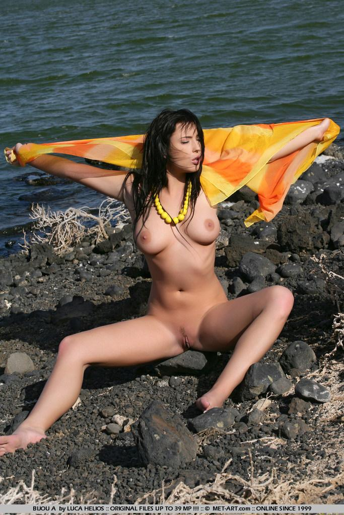 Naked Bijou is tempting on the rocky beach - 9