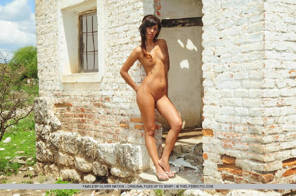 Young Yamile is posing naked in ruined house