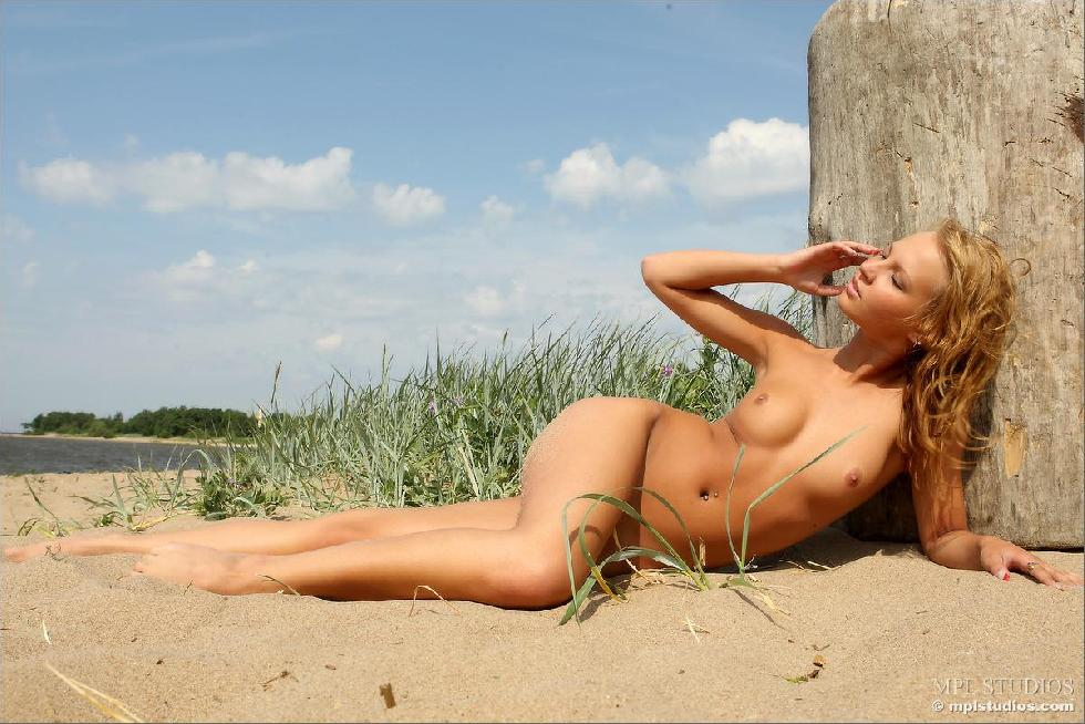 Tanned blonde on the beach - Lana