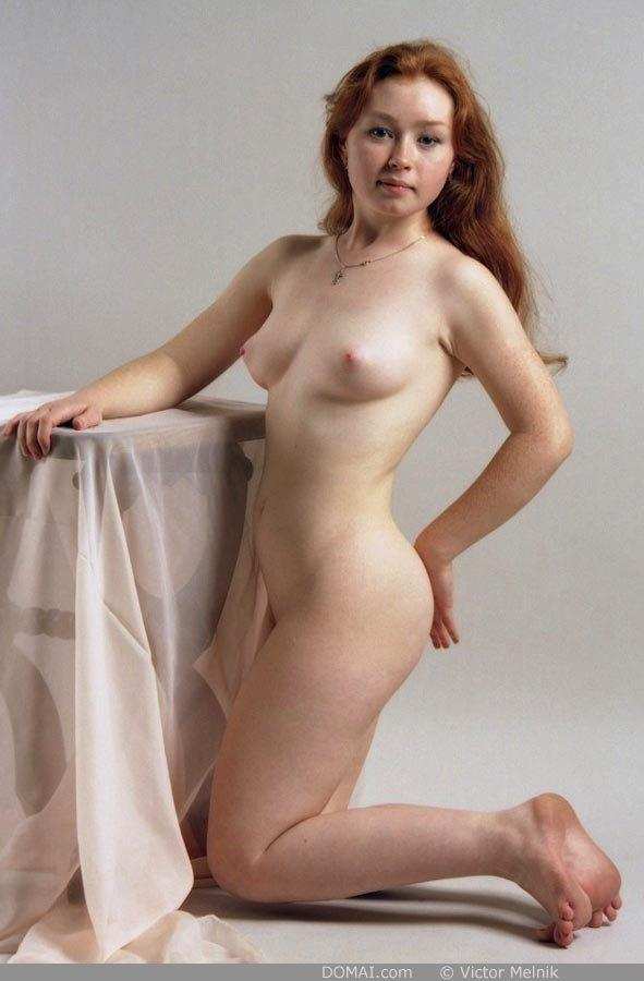 Naked red-haired Ginger in professional session