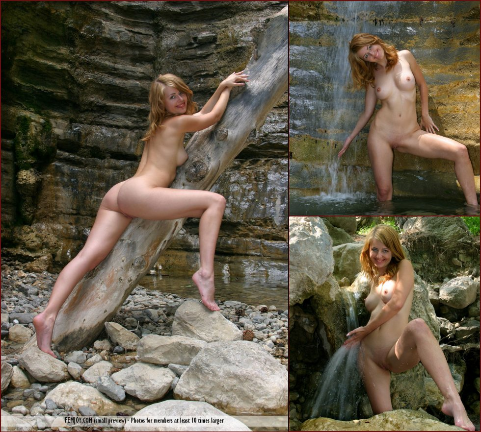 Mila is posing naked under waterfall - 33