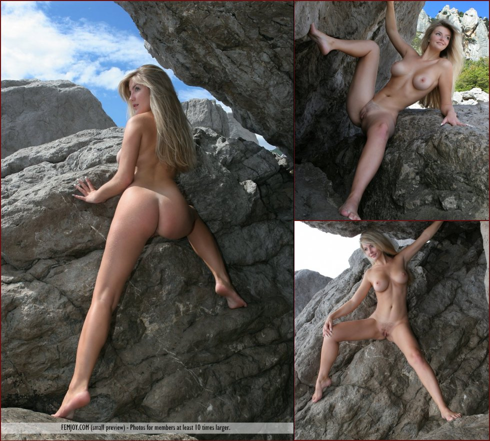 Long-haired Marta is posing naked on the rocks - 19