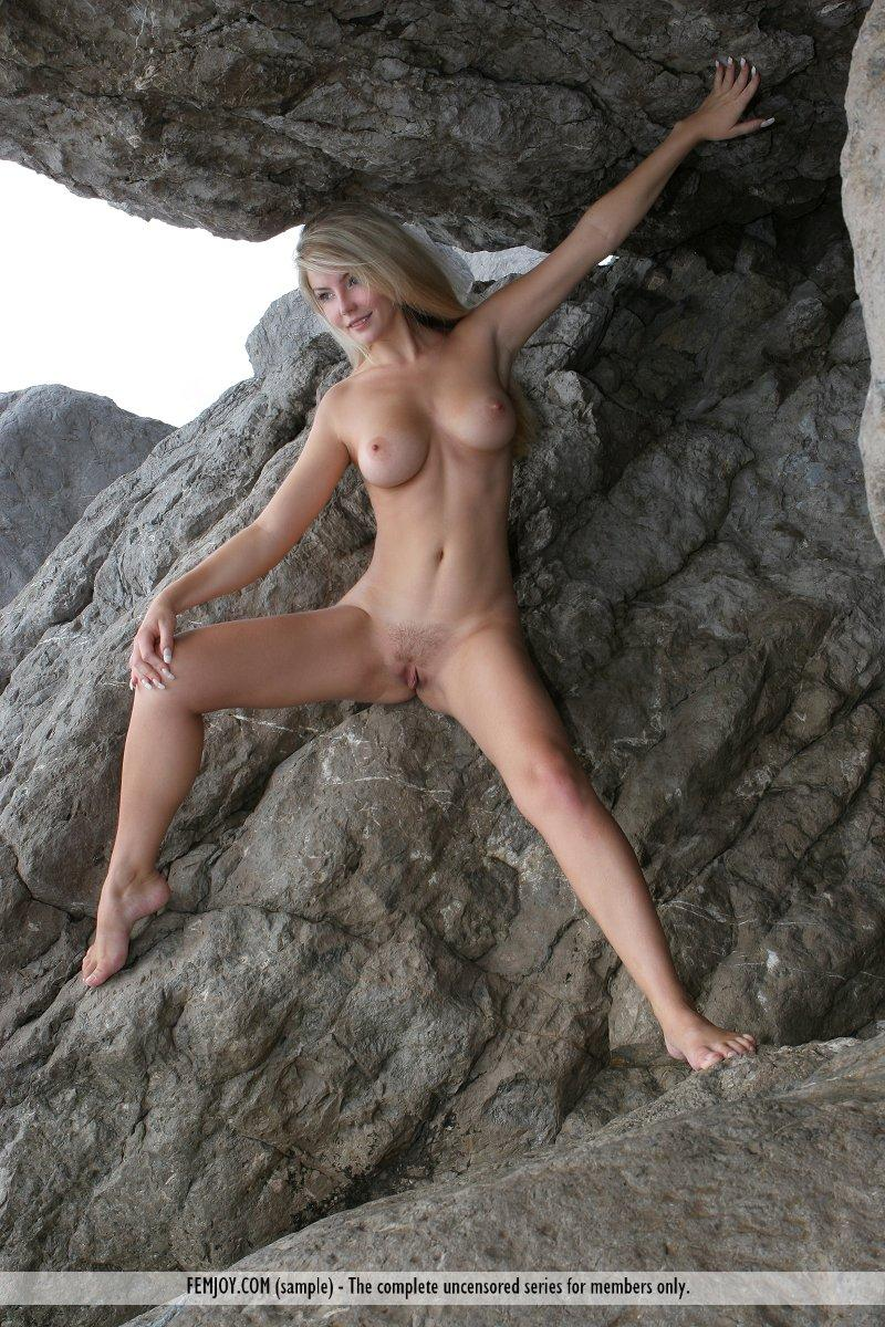 Long-haired Marta is posing naked on the rocks - 13