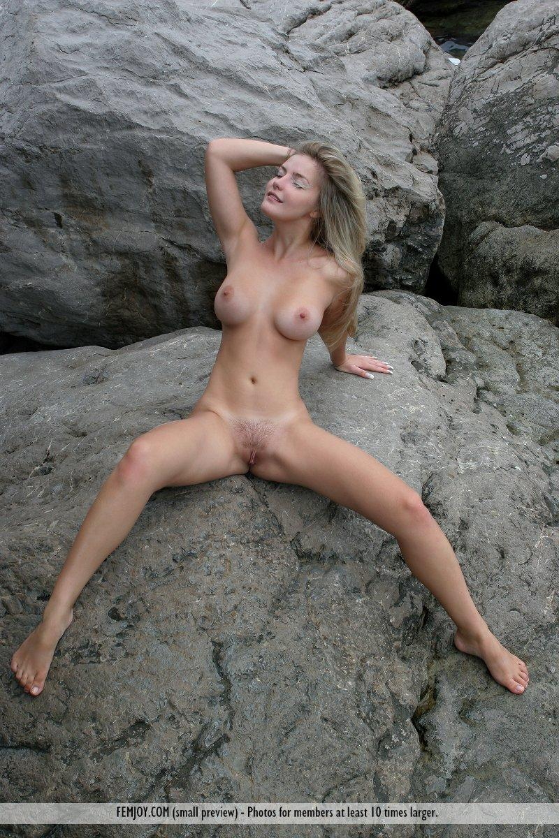 Long-haired Marta is posing naked on the rocks - 8