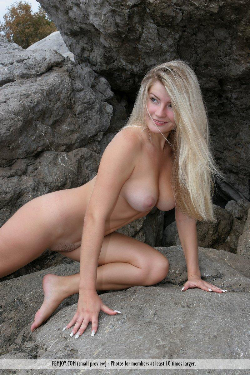 Long-haired Marta is posing naked on the rocks - 9