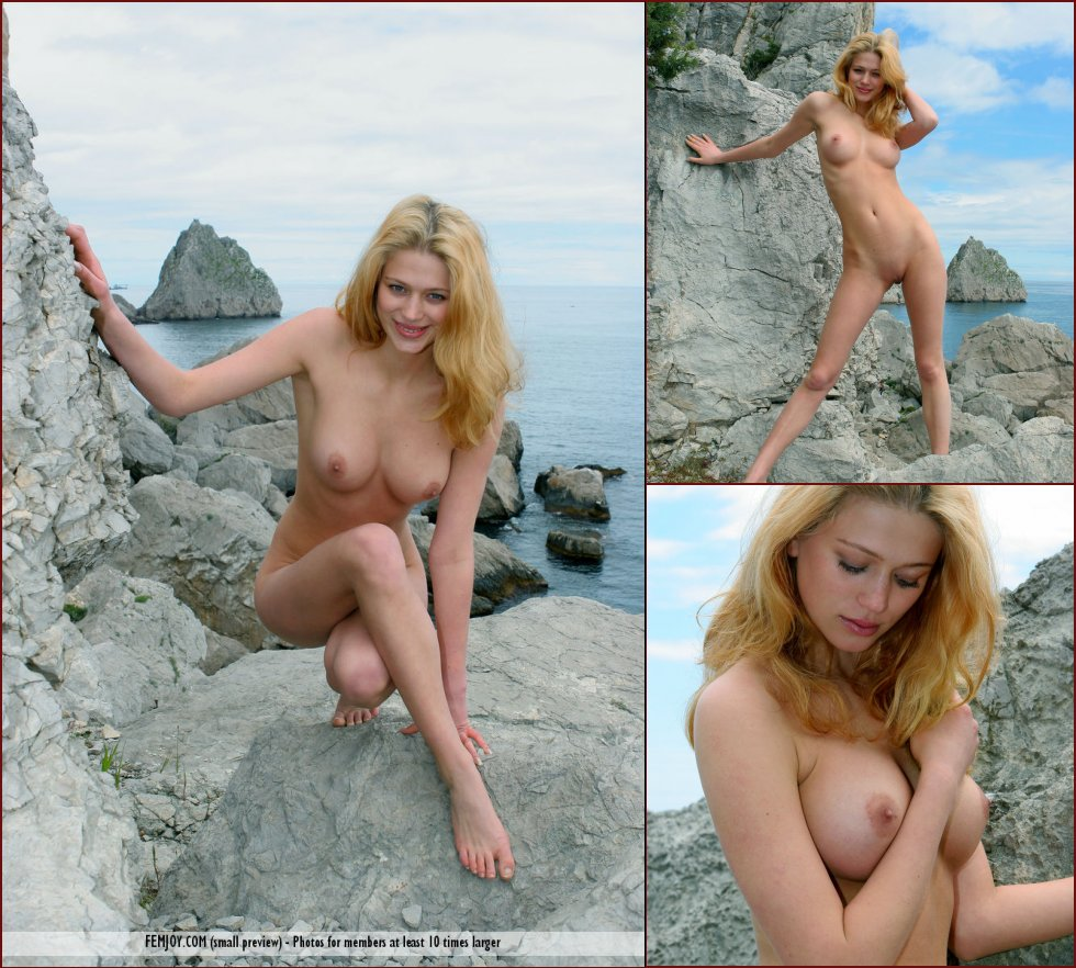 Naked blonde girl is posing on the rocks - Aida - 16