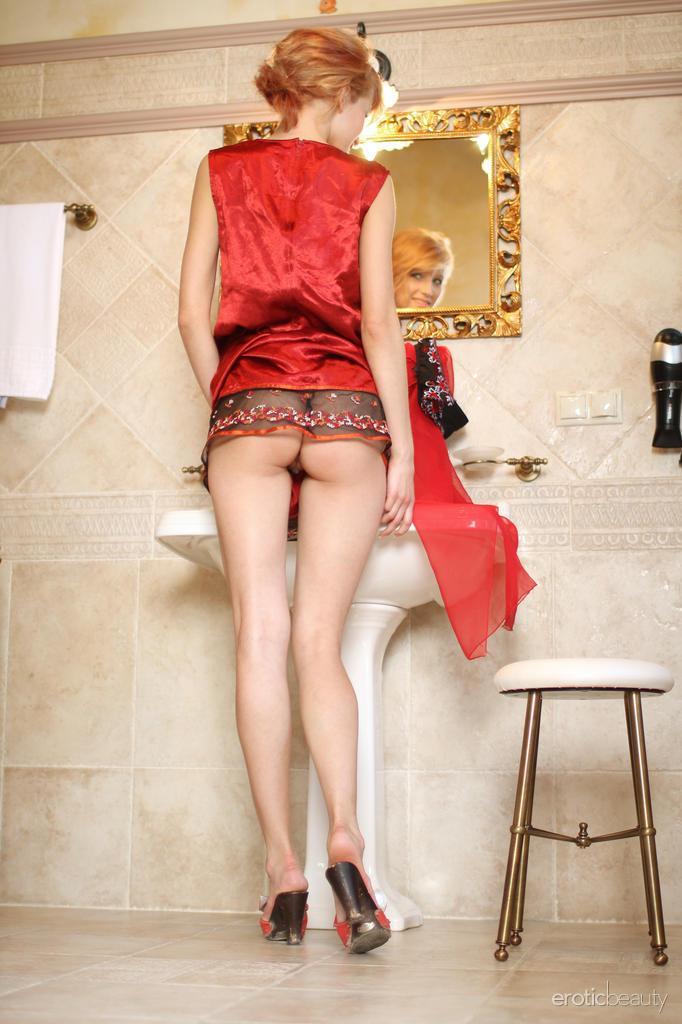 Stunning Mila is posing in the bathroom