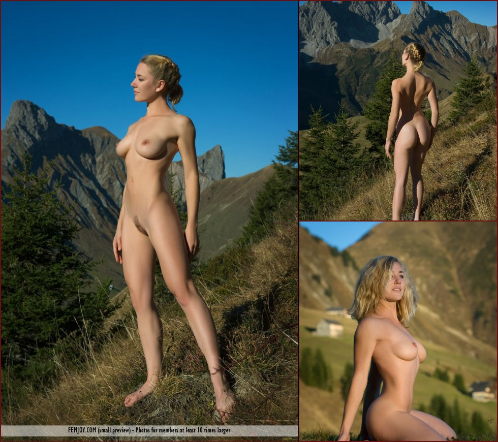 Naked Julia is posing on the mountain - 49