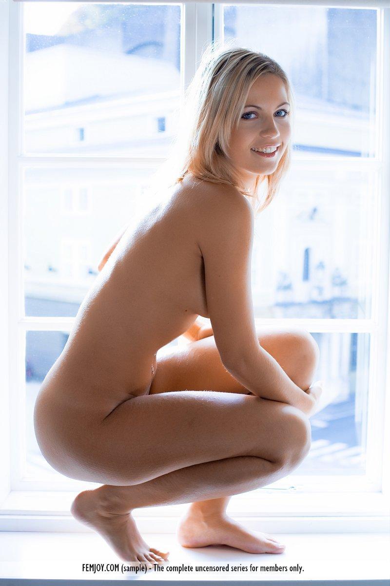 Magnificent blonde on the windowsill - Jenni - 11