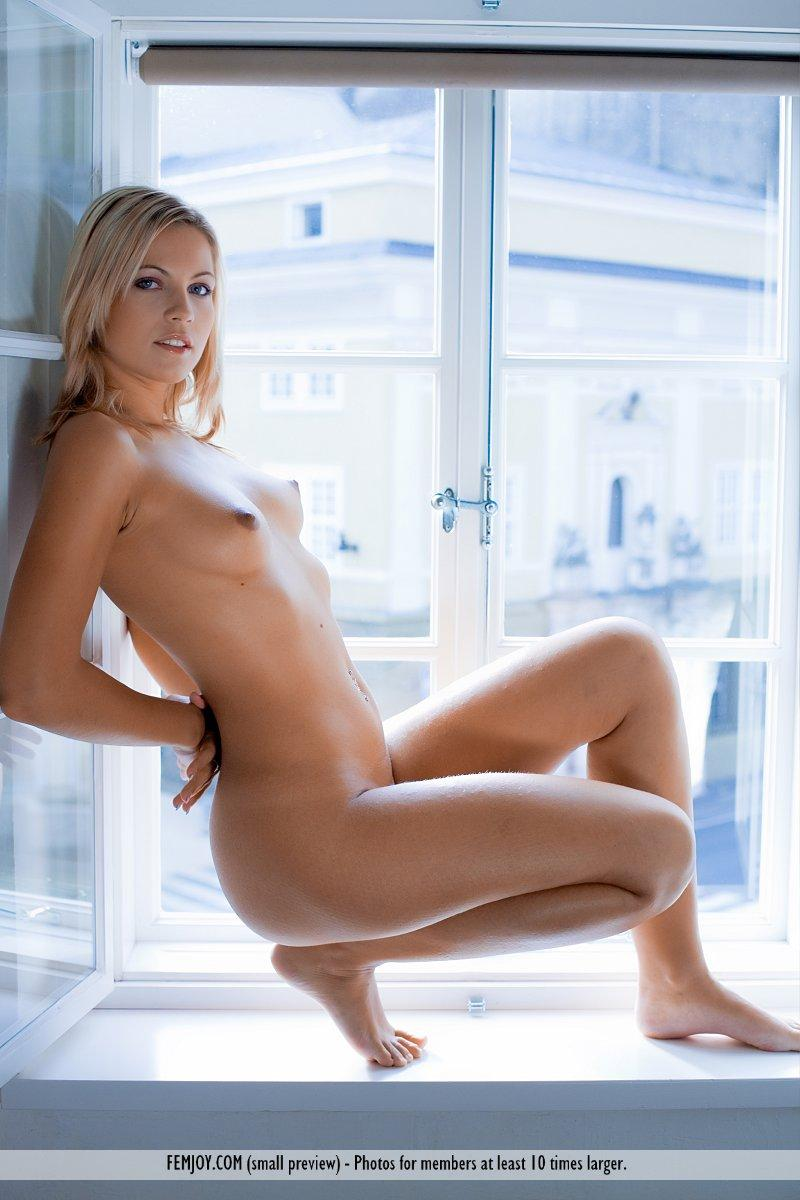 Magnificent blonde on the windowsill - Jenni - 12