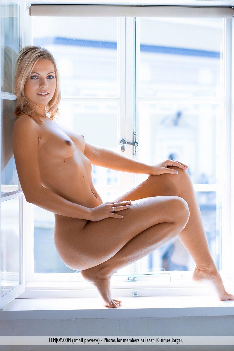 Magnificent blonde on the windowsill - Jenni - 13