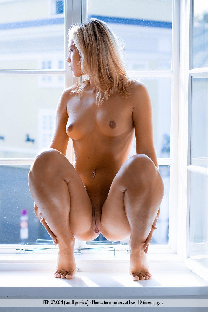 Magnificent blonde on the windowsill - Jenni - 16