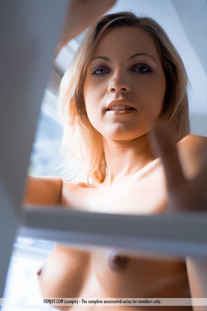 Magnificent blonde on the windowsill - Jenni - 7