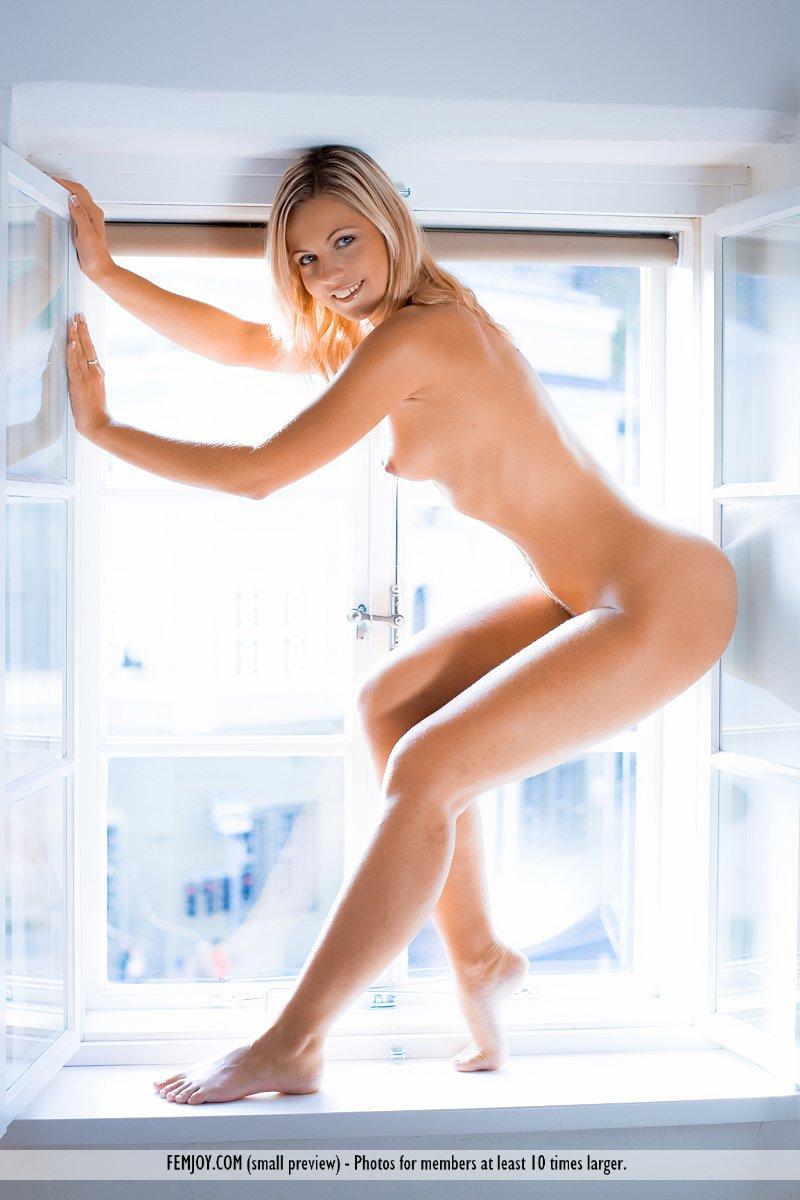 Magnificent blonde on the windowsill - Jenni - 8