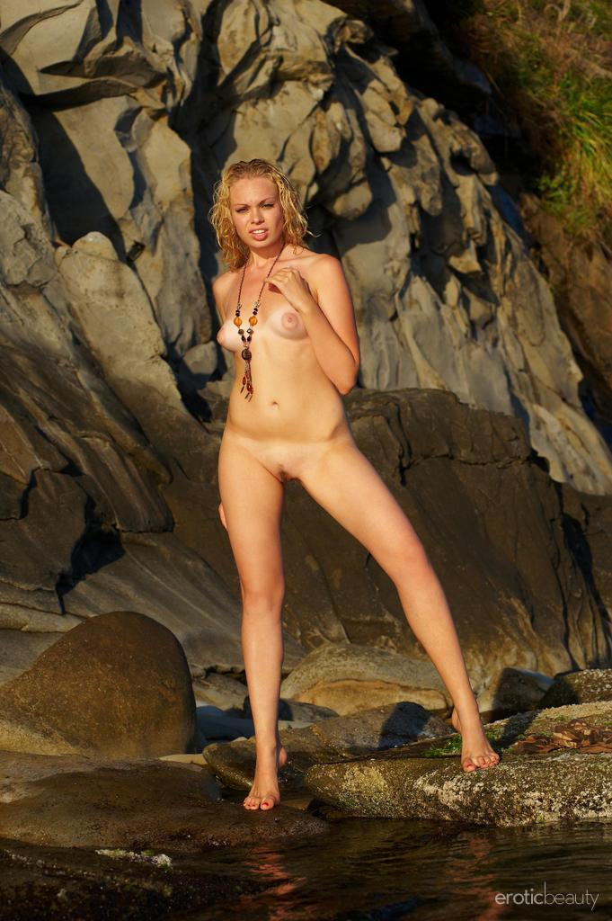 Naked Uma is posing at the sunset - 13