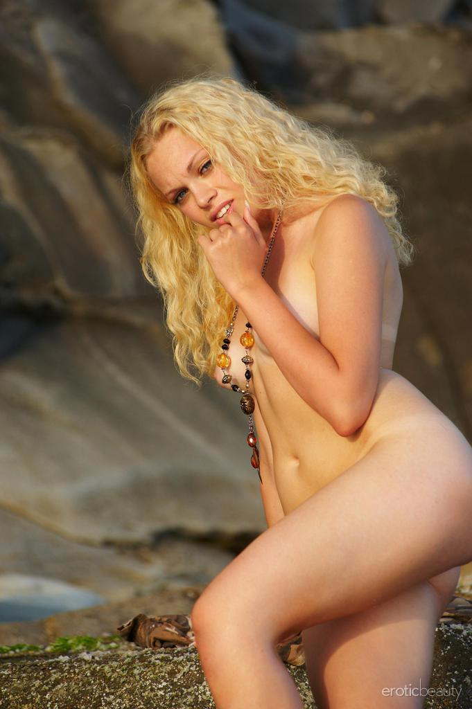 Naked Uma is posing at the sunset - 4