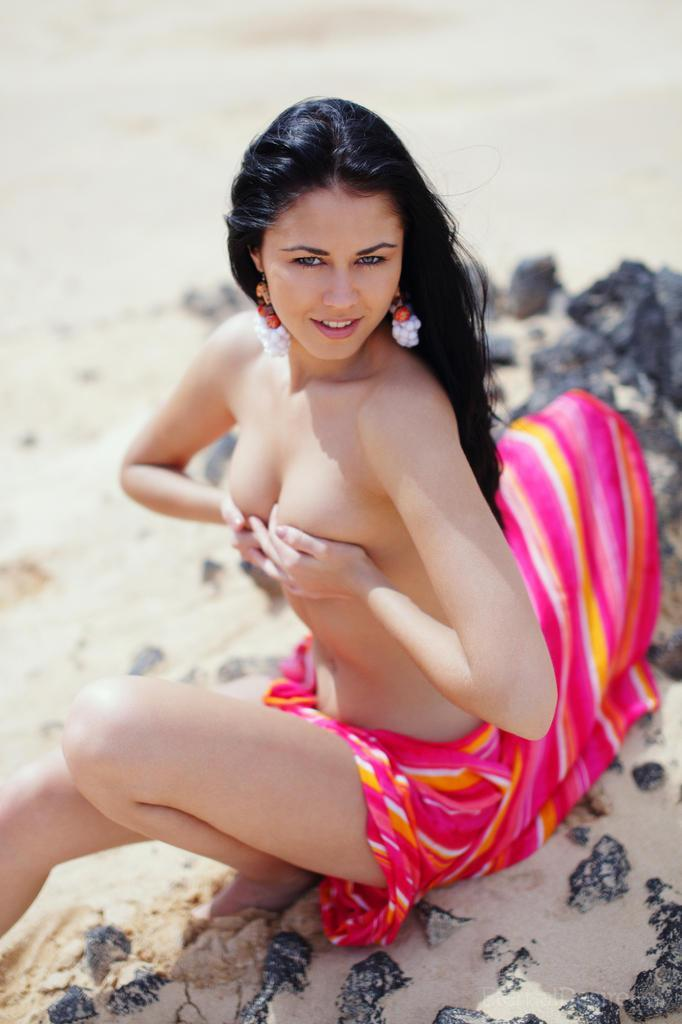 Charming Macy is posing on the beach - 16
