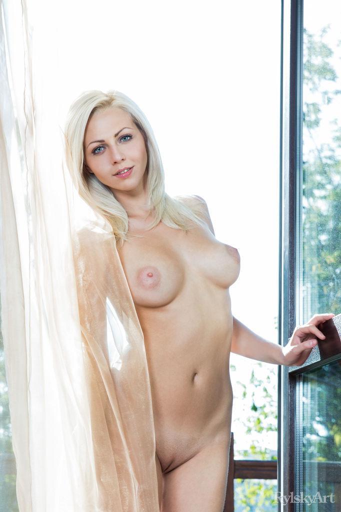 Blue-eyed blonde is spreading long legs - Lija - 2