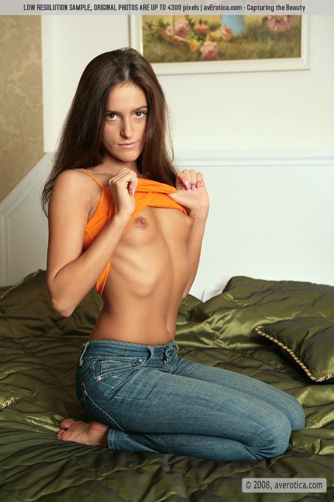 Tanned Jaqueline and her striptease on the bed - 4