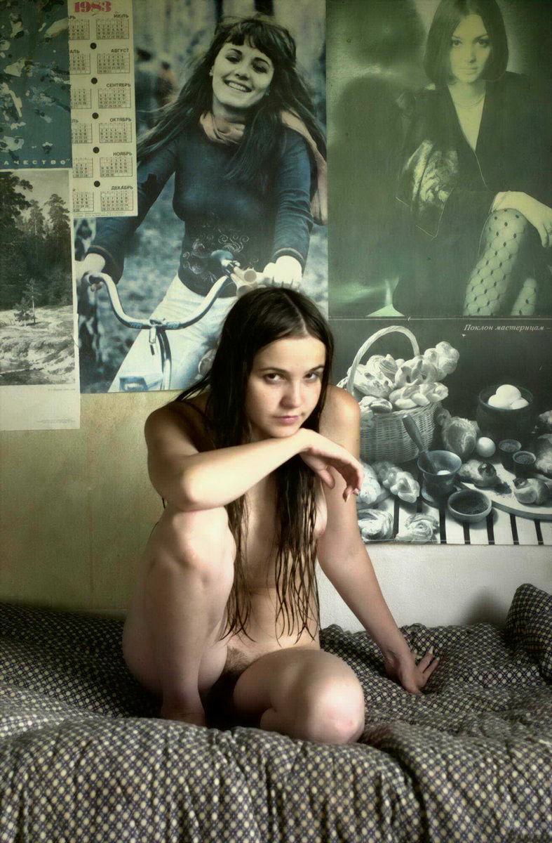 Naked teen is posing in her room