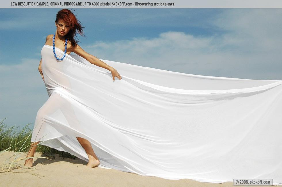 Sensual redhead is tempting on the beach - Mary