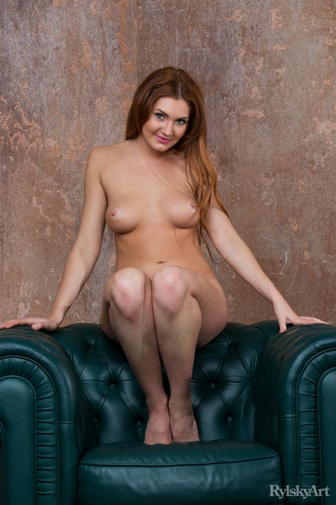 Naked Genie Agila is posing on the big armchair - Daily Ladies