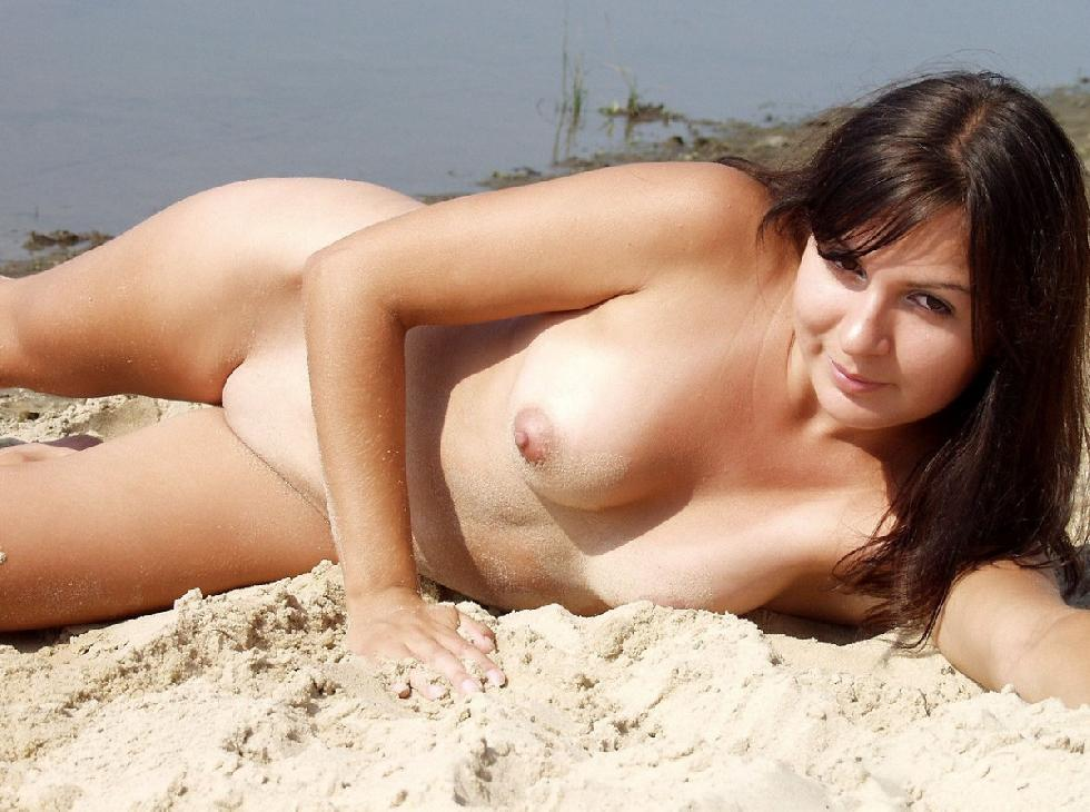 Naked brunette shows tanned body on the beach. Part 2